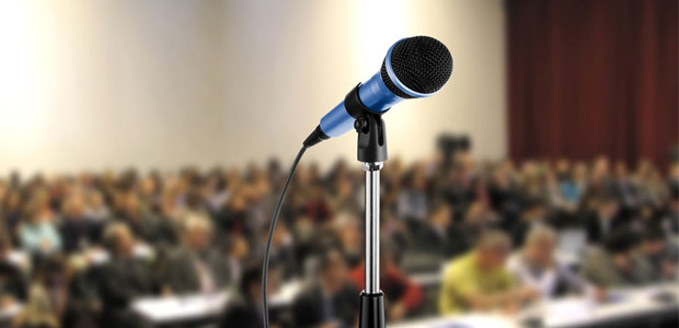 [Obrazek: Conference-podium-microphone-featured-image-620x300.jpg]